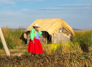 Utos woman in front of home on reed island