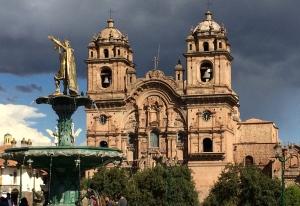 Cathedral and statue in Plaza de Armas in Cusco, Peru