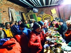 Bike Dreams cyclists dinner in remote police equipment shed - -2C and raining outside