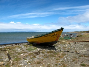 weathered fishing boat on beach in Tierra del Fuego